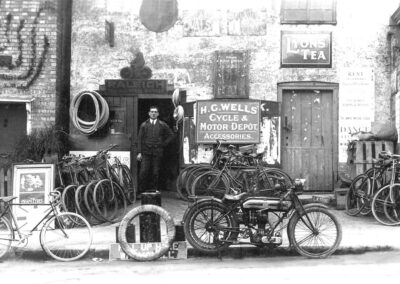 H.G. Wells outside his cycle shop over looking the Pond in 1924
