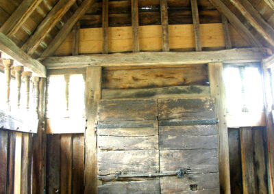 The wooden interior of the tower porch